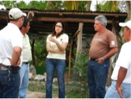 Claudia Carcámo, SHI-Honduras Country Director and Roy Lara, Lead Field Trainer, talking to some of the participants in the La Majada Land Ownership Project.