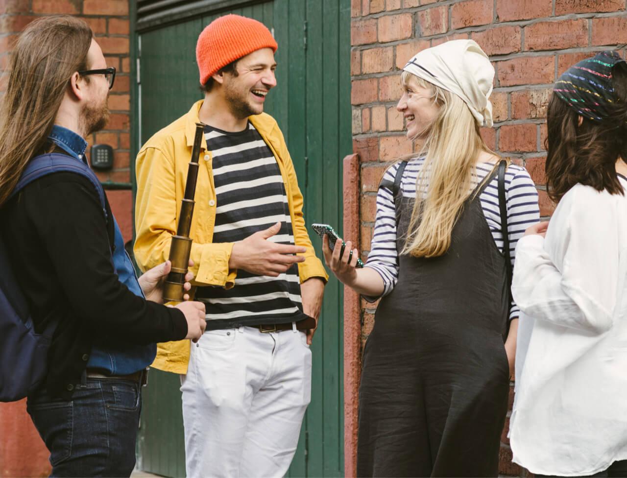 Group playing Treasure Hunt outside a warehouse