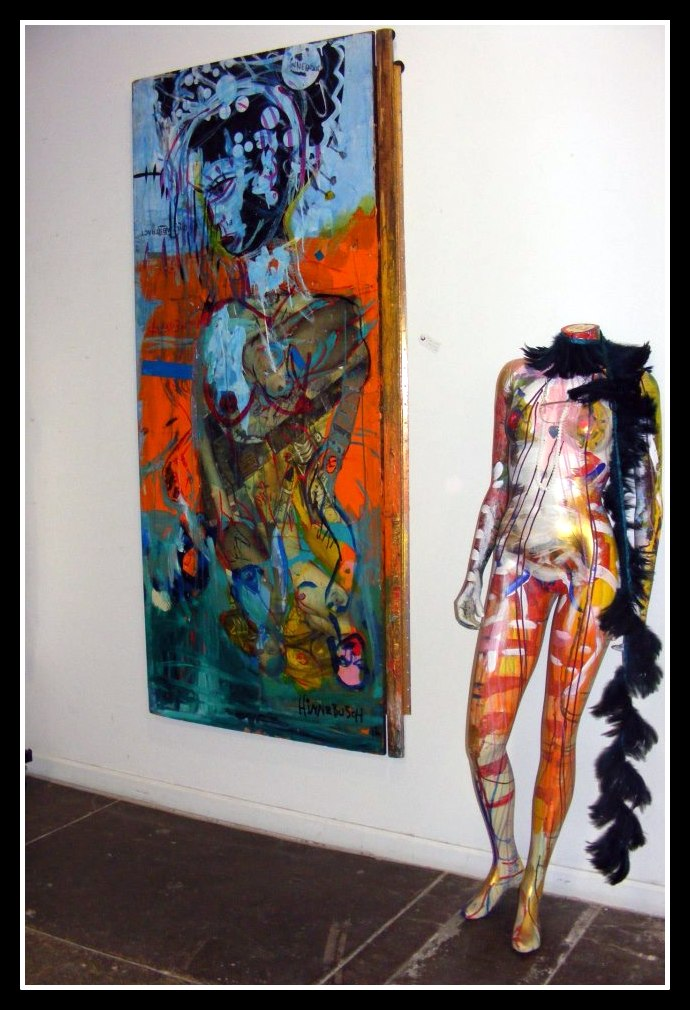 bright colored expressionistic painting and mannequin