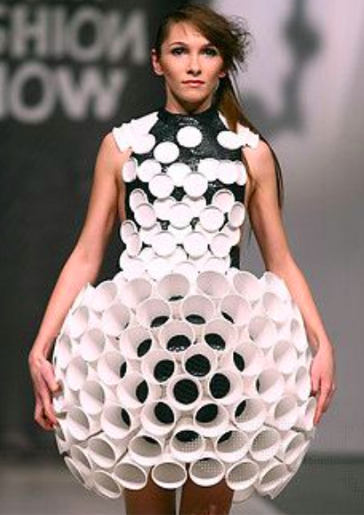 Model wearing dress made out of styroforam cups