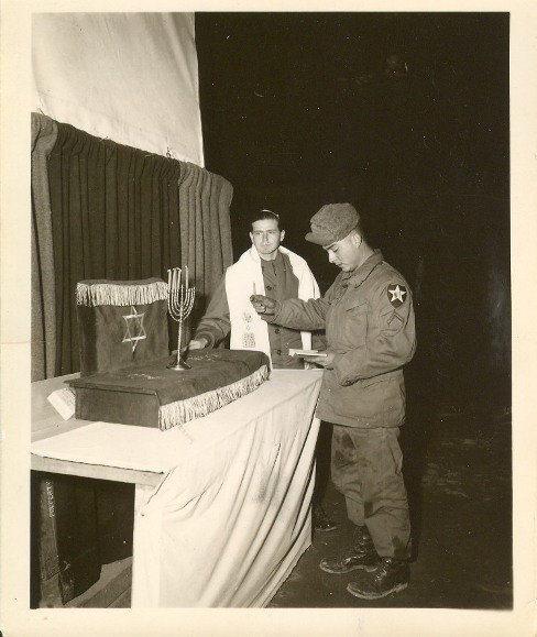 Chaplain Teitelbaum and a G.I. at a Hanukkah menorah lighting in 1952