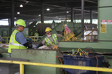 workers pulling cords at Cascade Recycling Center