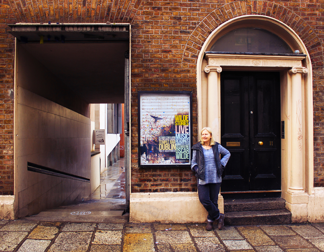 Visual Artist Felicity Clear beside her studio and Meeting House Square