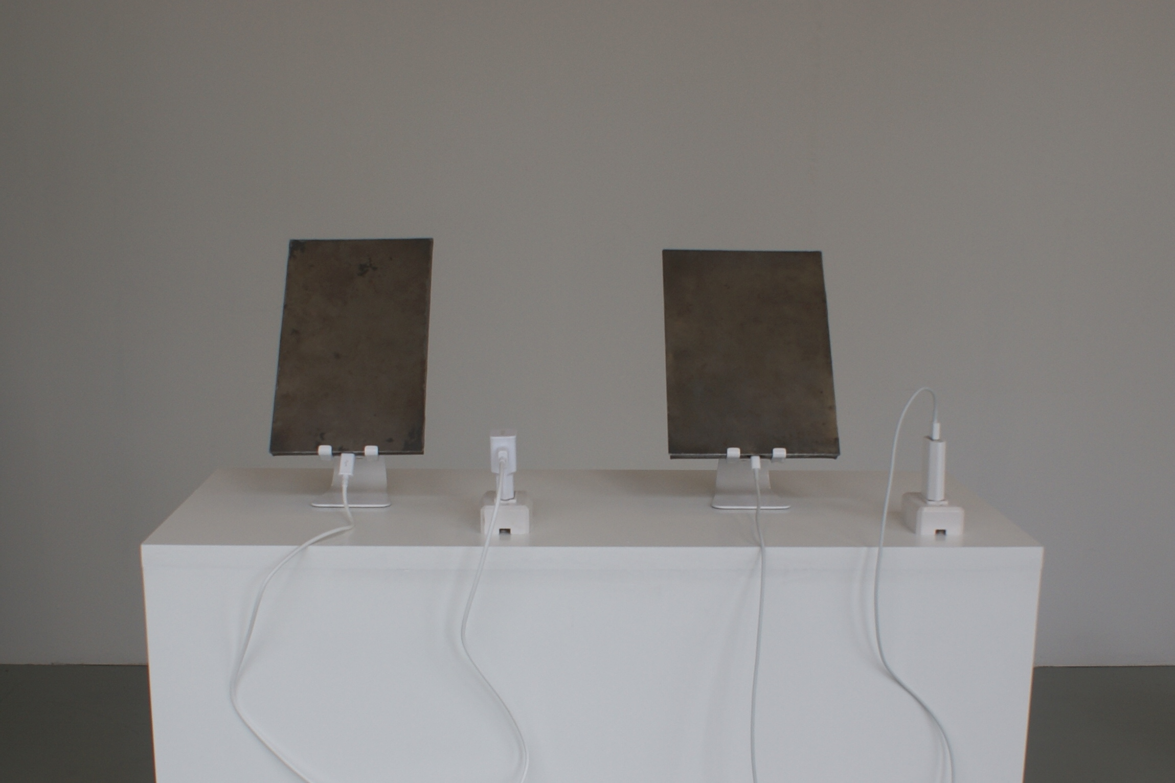 Dani Ploeger – Charging (2014-15). Two tablet computers have been made unbreakable. They have been wrapped in plate steel by traditional metal workers in Cairo. Only the charging sockets remain accessible. They will be charging for a long time.