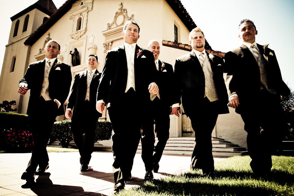 Groom and groomsmen confidently walking