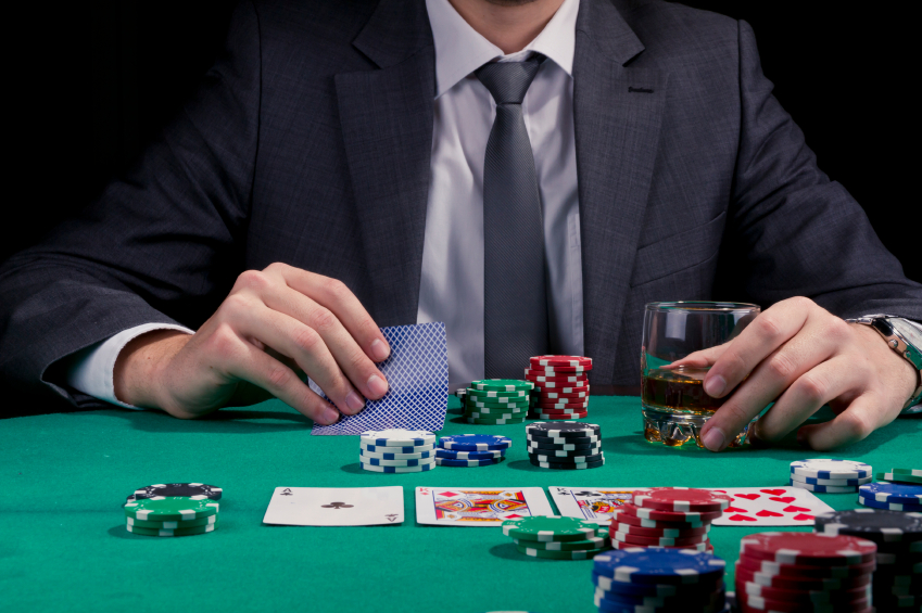 Guy in suit playing poker