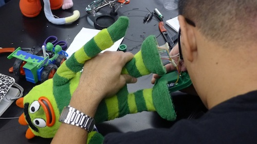 Green Alien Toy being modified for switch access