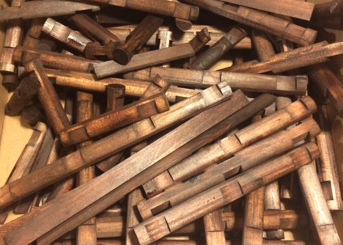 A very large pile of many lincoln logs
