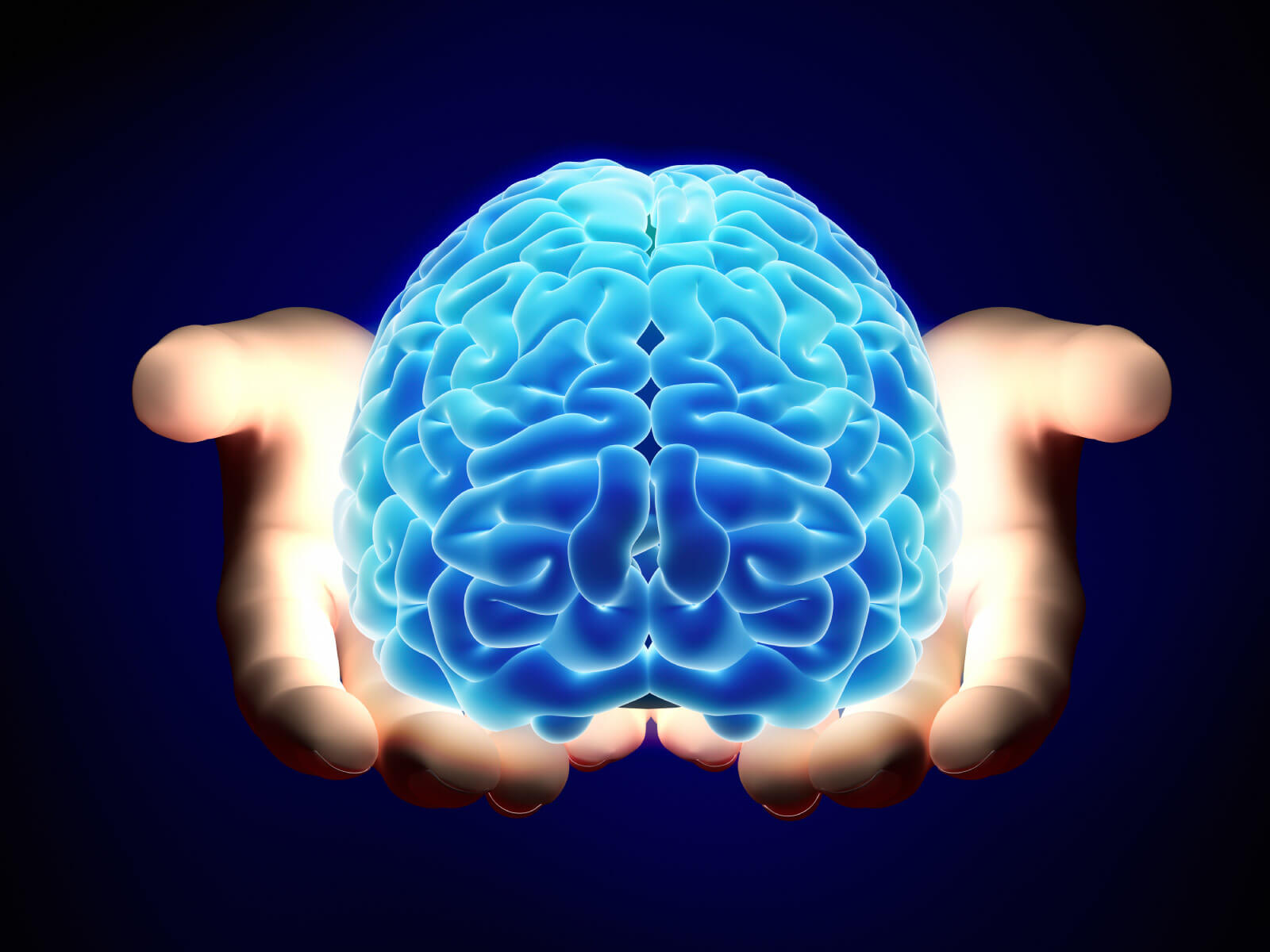 Glowing brain in hands