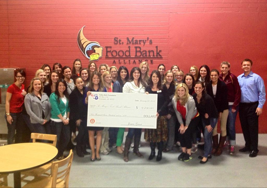 Ladies of Valley of the Sun Active 20-30 Club present St. Mary's Food Bank with $9,700 check from 2012 Holiday Wine Soiree.