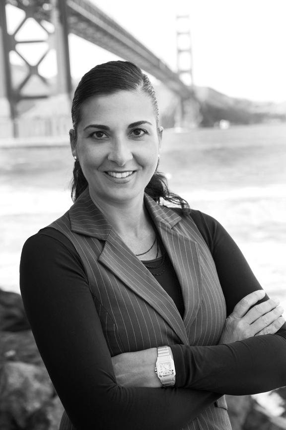black and white photo of Caroline Krogh-Jenson in front of Golden Gate Bridge