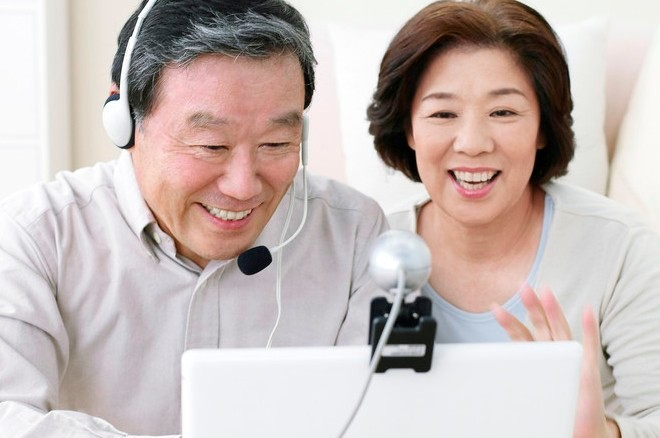 Asian couple with head phones and computer