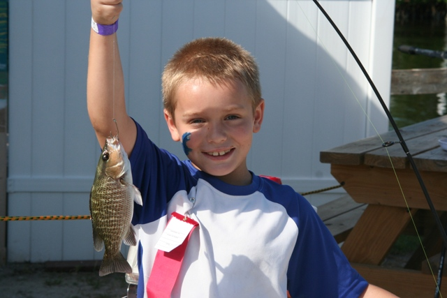Boy holds up his catch!