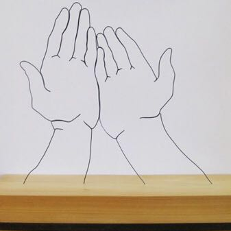 Wire drawing of hands on woodblock by artist, Gavin Worth