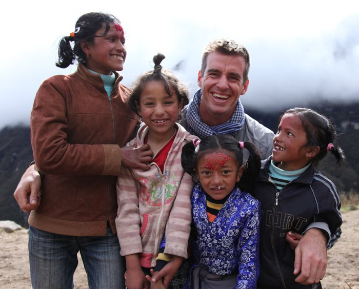 Brian Mockenhaupt and kids in Nepal