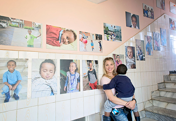 Tamara Lackey with her portrait gallery in an orphanage in Ethiopia