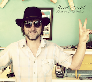 "reed foehl wearing a floppy hat and some sunglasses while he flashes a peace sign. this is the cover of his new CD ""Lost In The West"""