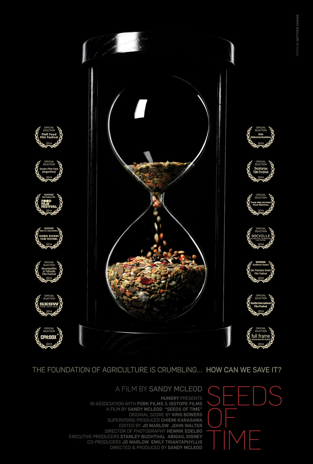 poster for the movie Seeds of Time, with a center image of an hourglass timer filled with grains instead of the expected sand
