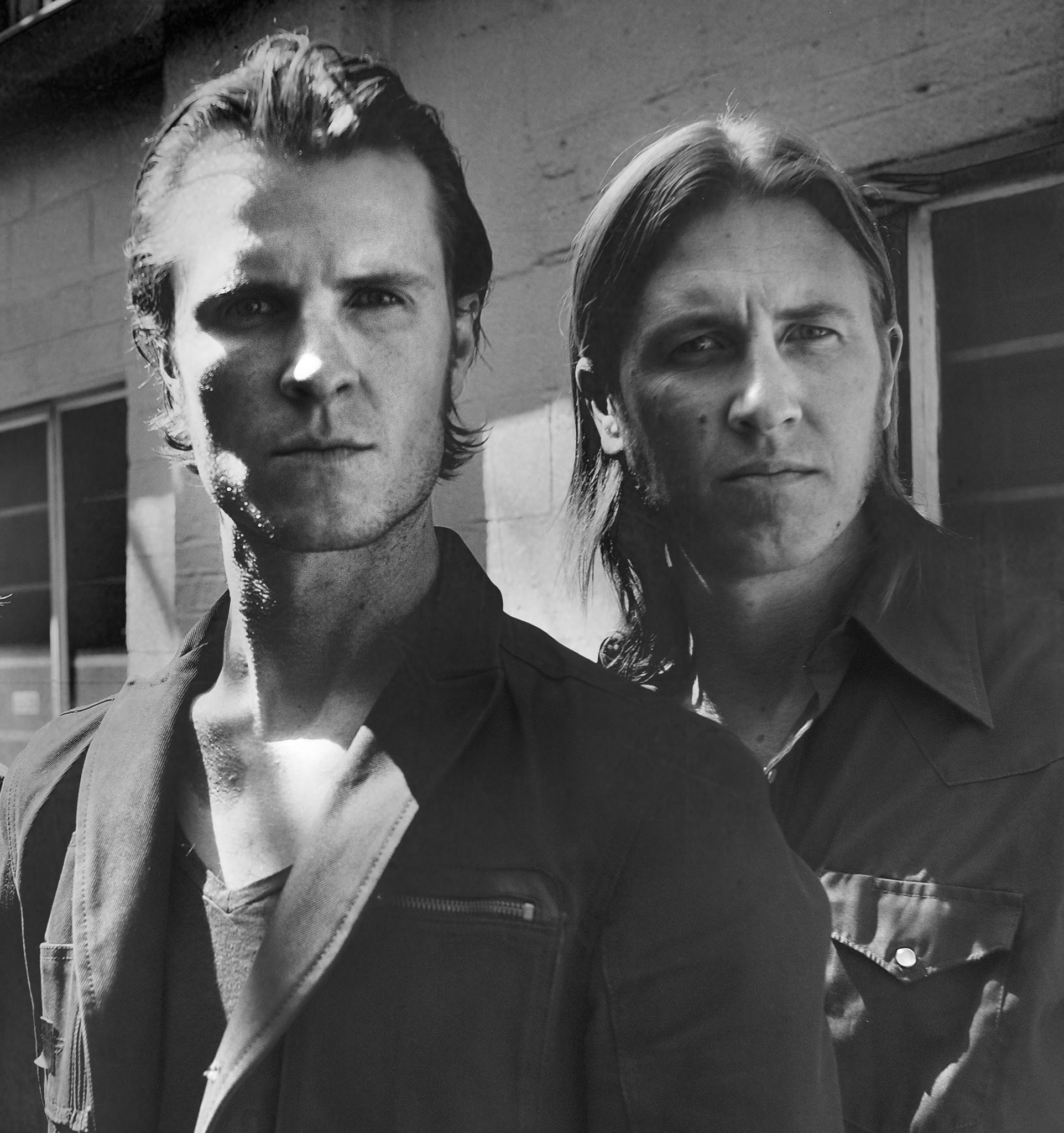black and white portrait of Josh & Seth Larson