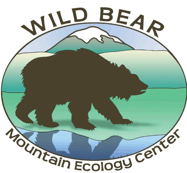 logo for wild bear mountain ecology center, with an illustrated bear walking in profile in front of a mountain backdrop