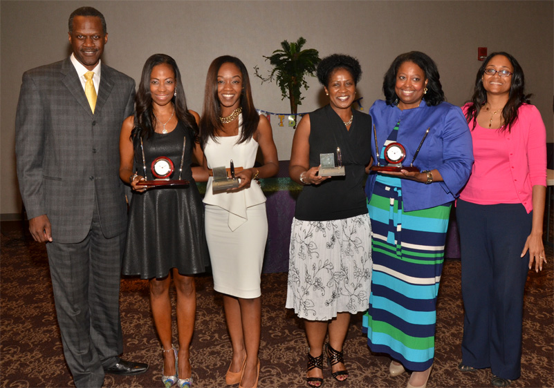 Al Watkins and Gayle Link pose with the valedictorians and salutatorians from Fall 2013 and Spring 2014