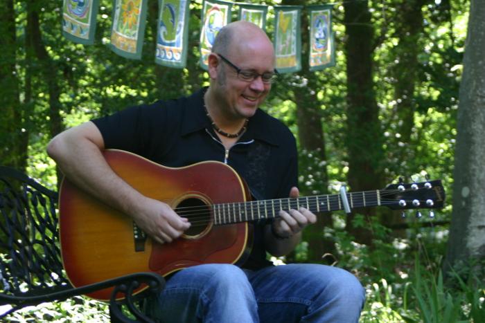 Bob Sima Singing and Playing Guitar