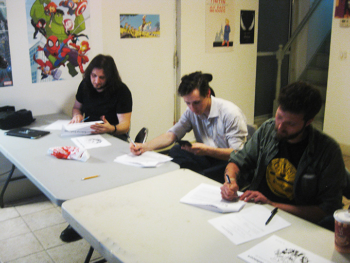 Students working on packets at Business Basics for Freelancers, Anyone Comics