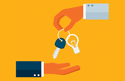 handing over key and lightbulb (iStockphoto)