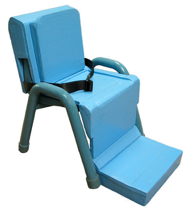 Adaptive insert over standard classroom chair