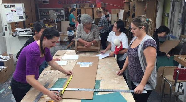 Adaptive Design Association's workshop, with students and instructor working on cardboard projects