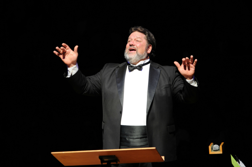 Choral Director Jim Raycroft conducting