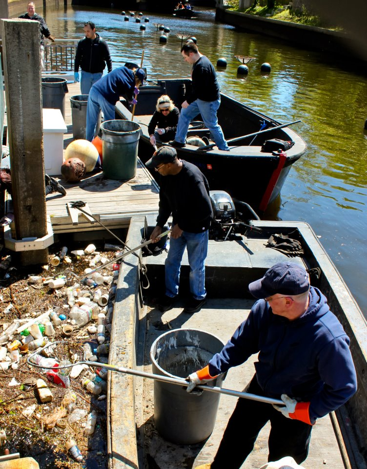 Volunteers hard at work cleaning debris from the river.