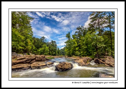 Located only 15 miles (24 kilometers) from downtown Atlanta, the 2,549 acres Sweetwater Creek State Park offers 9 miles (14 kilometers) of hiking trails. The main attraction, however, is Sweetwater Creek, a 45.6-mile-long (73.4 kilometers) stream, featuring many cascading waterfalls.