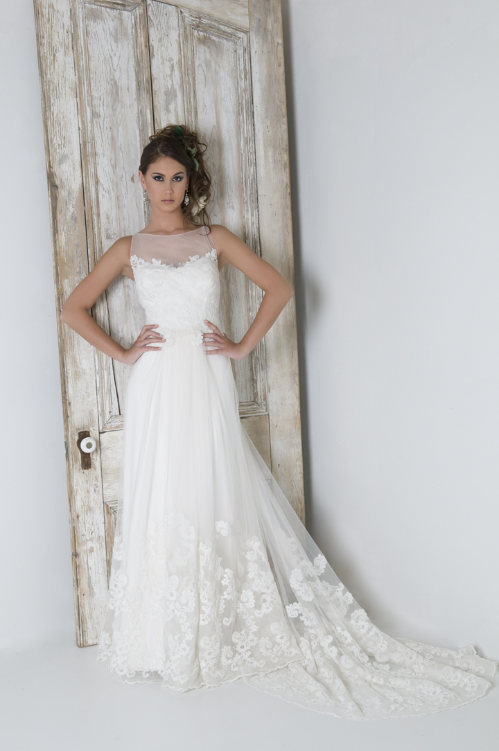 Lace illusion neckline with a flowing long tulle train