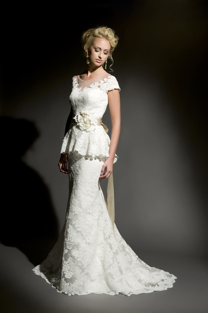 re-embroidered lace with sheer illusion neckline and lace peplum over skirt.