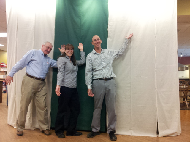 Baron's Major Brands employees Chuck, Heidi & Jon at the mysterious curtain where clandestine Baron's Belmont Showroom improvements are underway….