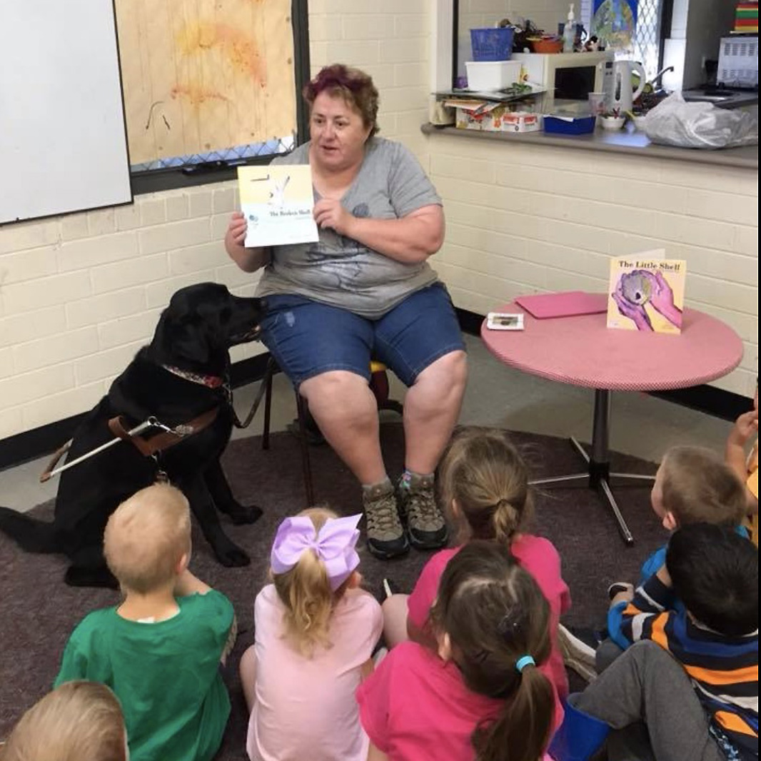 Leonie reading to children