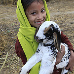 Mira Sunwar (7) holds a family goat at her home in Tleyanpur Village, Nepal