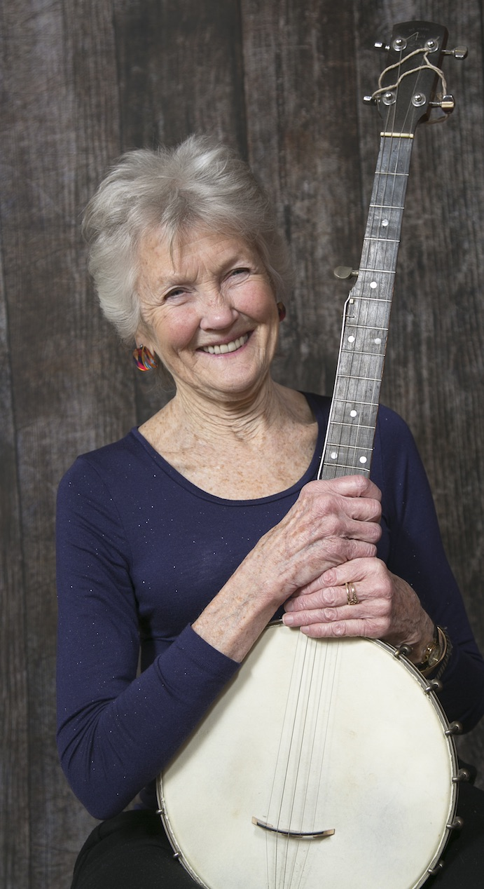 Peggy Seeger with banjo smiling. Photo by Vicki Sharp Photography