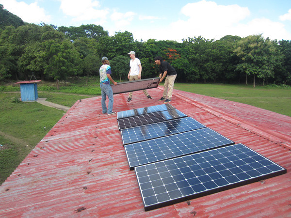 Installing solar panels on a school in Santa Ana