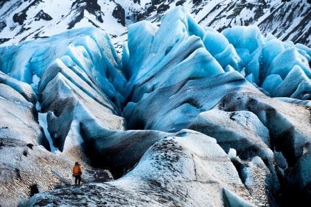 Man walks across incredible ice formations