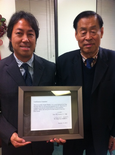 Atsuki Maeda presented with certificate by Dr. Shi