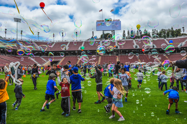 Kids play in the outrageous bubble storm at Children's Champions