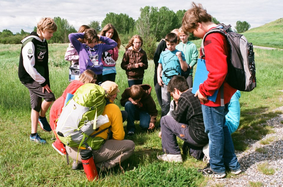 Julie Walker explores local plants with a group of elementary students