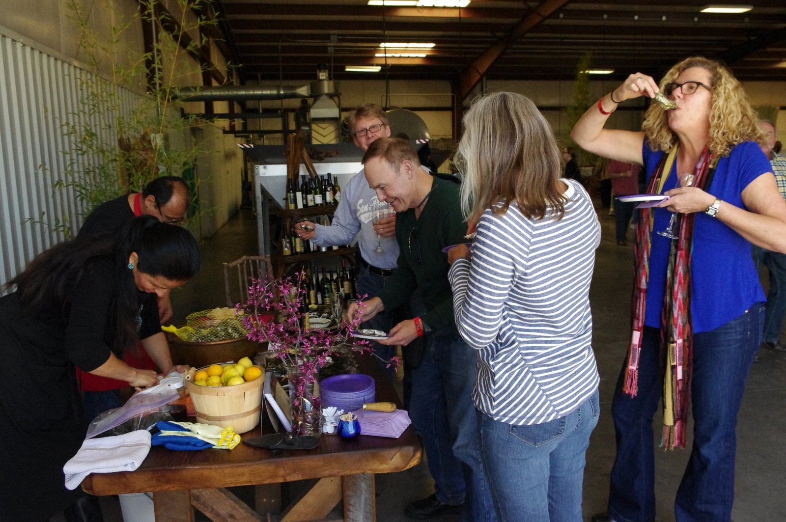 festival attendees enjoying oysters from tomales bay oyster company