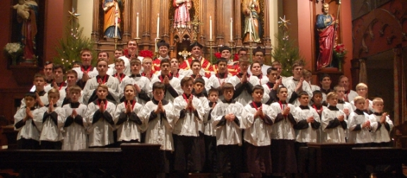 Fr. McNeely with altar boys at St. Stephen