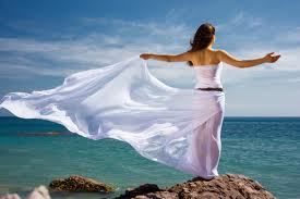 Freedom - Beautiful Woman in the breeze overlooking the ocean