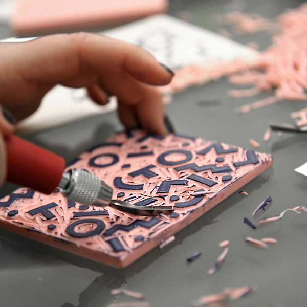 Carve personalized rubber stamps for paper tickets wed