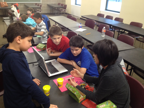 kids working with Arduino boards