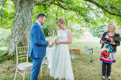 Couple getting married under the sycamore tree